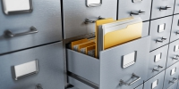 Filing cabinet with a single yellow folder in an open drawer - УППЧ